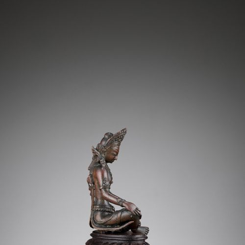 A NEPALESE COPPER FIGURE OF INDRA Nepal, 15 th 17 th century. Cast seated in ele…