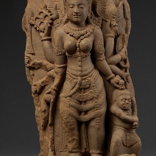 A VOLCANIC STONE STELE OF DURGA SLAYING THE BUFFALO DEMON, 11TH 13TH CENTURY Ind…