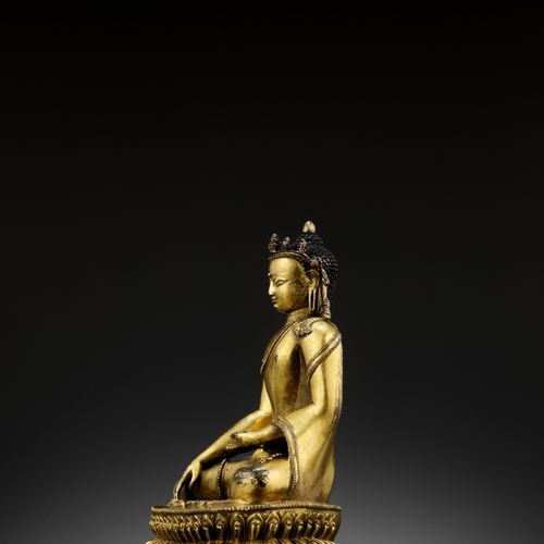 A GILT COPPER ALLOY FIGURE OF A CROWNED BUDDHA, MALLA, 14TH 15TH CENTURY Nepal, …
