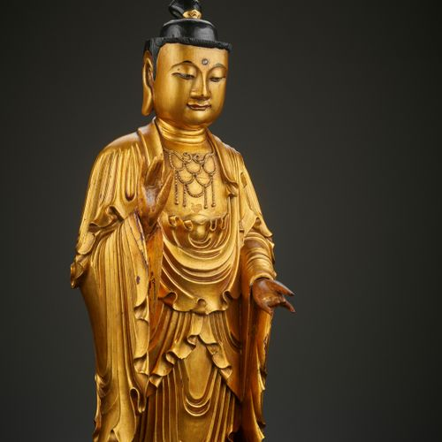 A GILT LACQUERED WOOD FIGURE OF BUDDHA, QING DYNASTY China , 18 th century. Carv…