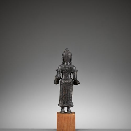 A BRONZE FIGURE OF UMA, LOPBURI STYLE, 13TH 15TH CENTURY Thailand. Cast standing…