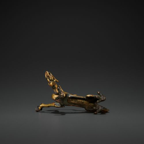 A RARE GILT BRONZE FIGURE OF A DRAGON, TANG DYNASTY China, 618 907. Finely cast …