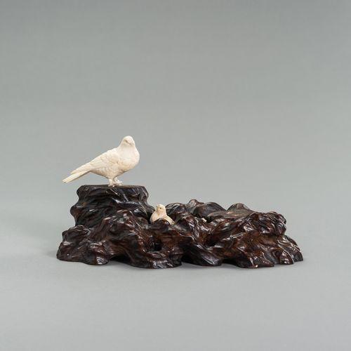 AN IVORY OKIMONO GROUP OF A COUPLE OF BIRDS WITH CHICKS AN IVORY OKIMONO GROUP O…