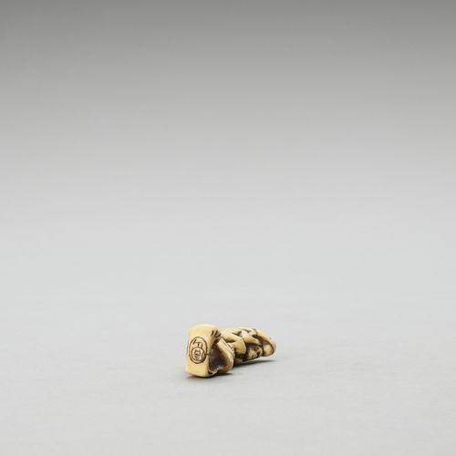 A STAG ANTLER NETSUKE OF THE THREE WISE MONKEYS A STAG ANTLER NETSUKE OF THE THR…