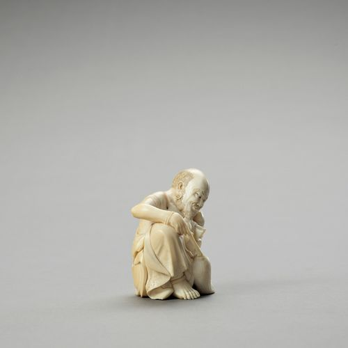 AN IVORY OKIMONO OF A RAKAN CLEANING HIS EAR AN IVORY OKIMONO OF A RAKAN CLEANIN…