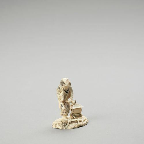 AN IVORY OKIMONO OF A TEMPLE DRUMMER AN IVORY OKIMONO OF A TEMPLE DRUMMER Signed…