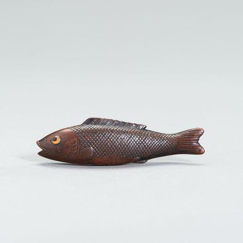 A LARGE WOOD FISH NETSUKE A LARGE WOOD FISH NETSUKE Japan, 19 th century Depicti…