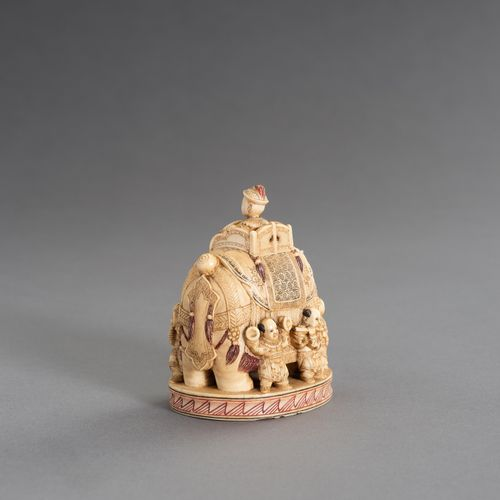 CHIKUYÔSAI TOMOCHIKA: AN IMPRESSIVE IVORY OKIMONO OF A CAPARISONED ELEPHANT WITH…