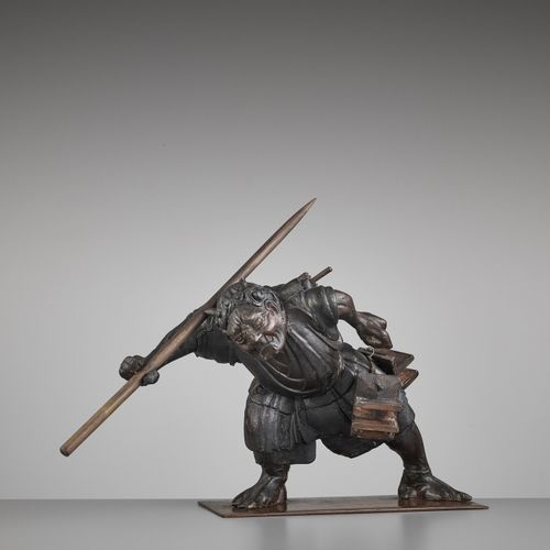 A LACQUERED WOOD OKIMONO OF AN ONI A LACQUERED WOOD OKIMONO OF AN ONI Japan, lat…