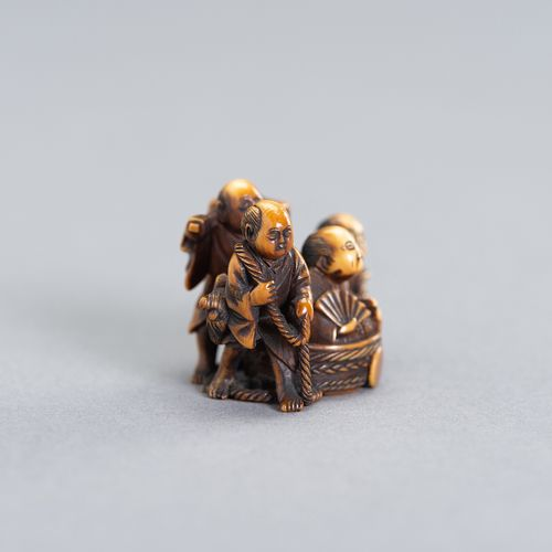 A SMALL IVORY NETSUKE OF A GROUP OF SAMURAI AND FARMERS A SMALL IVORY NETSUKE OF…