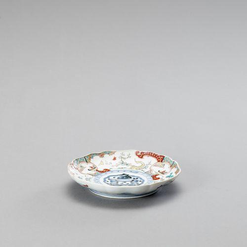 A FINE IMARI PORCELAIN PLATE A FINE IMARI PORCELAIN PLATE Japan, 18 th 19 th cen…