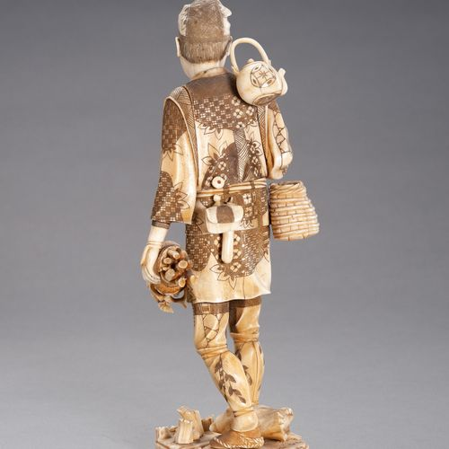 AN IVORY AND BONE OKIMONO OF A WOOD GATHERER AN IVORY AND BONE OKIMONO OF A WOOD…
