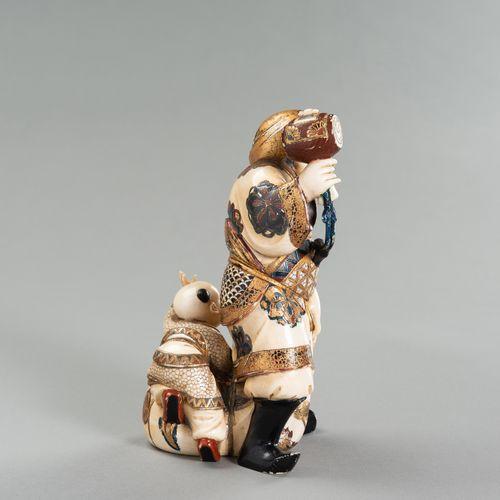 A LACQUERED IVORY OKIMONO OF DAIKOKU AND KARAKO A LACQUERED IVORY OKIMONO OF DAI…