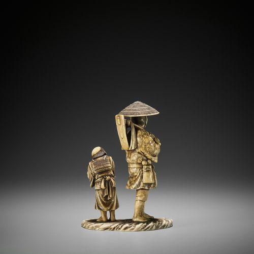 SHODAI: AN IVORY OKIMONO OF A FARMER WITH CHLD SHODAI: AN IVORY OKIMONO OF A FAR…