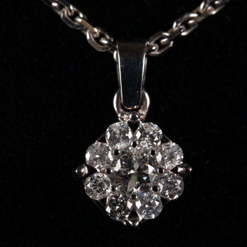 Collier en argent, avec pendentif en or blanc avec un diamant de 0,7 carat
