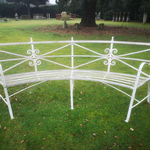 Garden seats: A pair of rare Regency reeded wrought iron curved seats early 19th…