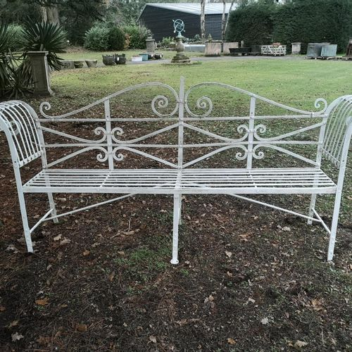 Garden seats: A Regency reeded wrought iron seat early 19th century 240cm wide