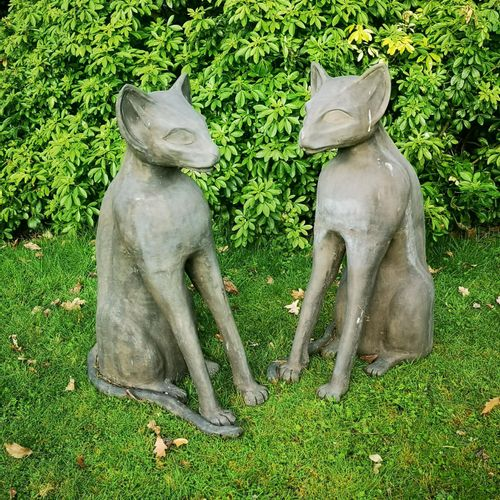 Modern and Garden Sculpture: Gerald Moore A pair of Egyptian style seated cats R…