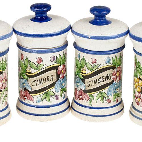 Six earthenware cylindrical pharmacy jars with polychrome decor: 'Pineapple', 'C…