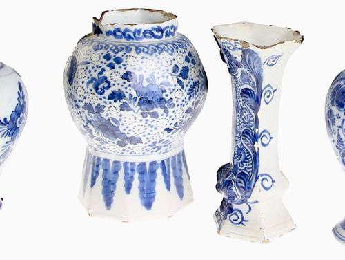 Four Delft earthenware vases, 18th century H. 16 to 19 cm, all with defects