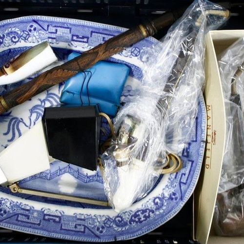 Five pipes, including porcelain and wood, one decorated with an image of a stude…