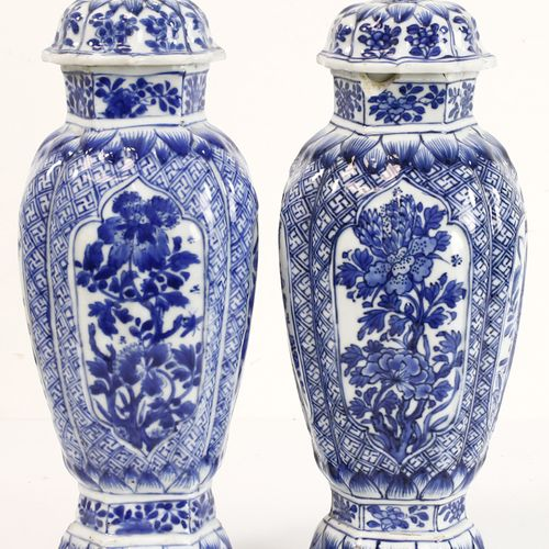 Pair of Chinese porcelain lidded vases with blue white floral and swastika decor…