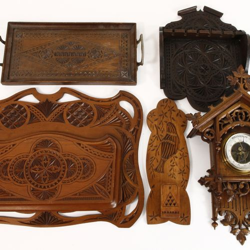 Four wooden carvings including a pipe rack, match holder and newspaper rack, Hol…