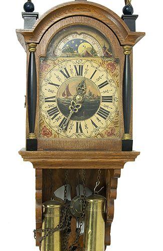 钟表 20世纪下半叶,带有手绘表盘和三个铜制人物的仿真船钟,以及一个大约1900年的复合台钟 缺陷