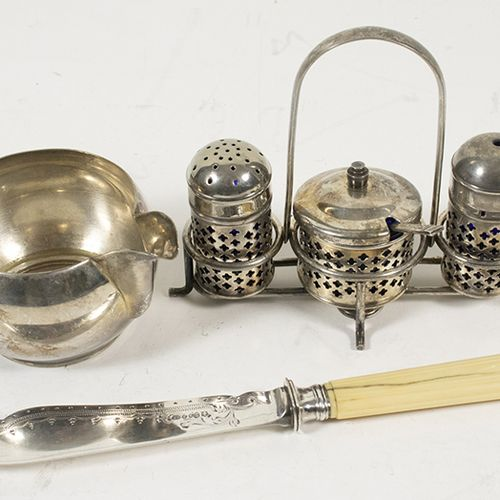 Silver plated and gilt objects An English silver plated salt, pepper and mustard…