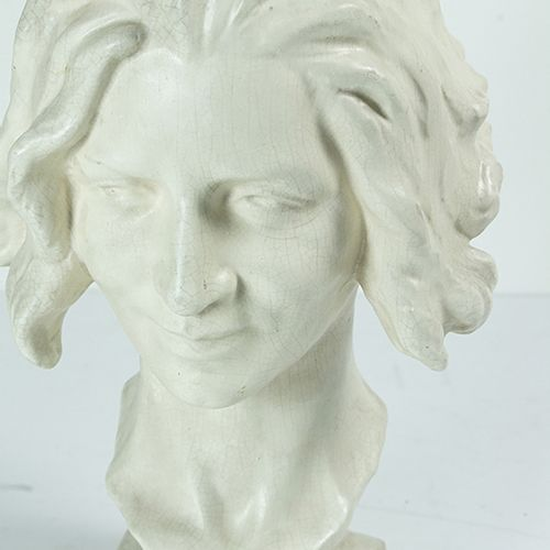 Statues, figures etc. A plaster bust of a female head on a tall marble base h. B…