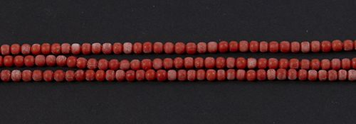 Gold jewellery and objects Three strand coral bead bracelet completed by a 14k y…