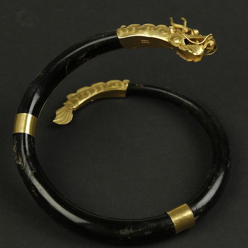 Gold jewellery and objects 18k yellow gold and Ahar Bakar bangle shaped like a s…