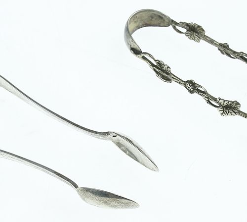 Silver objects Flatware, Netherlands Two silver sugar tongs, one with reeded bor…