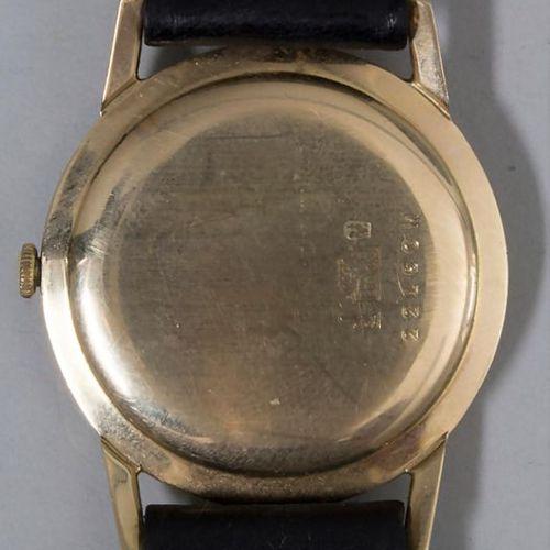 HAU / A men's wristwatch, Mondia, Schweiz, um 1960 Gehäuse: 14 Kt.585/000 Gold, …