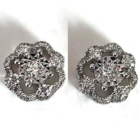 PAIRE de boutons d'oreilles en or gris sertie de diamnts poids 2.5 g