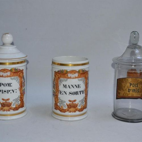 Three PHARMACY JARS, two of them in porcelain and glass H.: 17.5 cm 25 cm and 26…