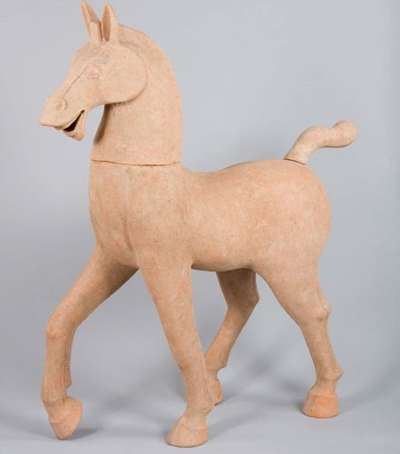 Large ochre terracotta piaffant horse, the head and tail are removable.China, Ha…