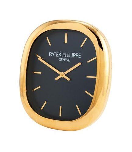 Patek Philippe, Ellipse, a gilt brass wall clock Patek Philippe, Ellipse, a gilt…