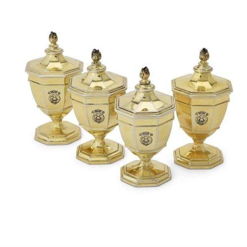 A set of four silver gilt octagonal vase shape salt cellars by Carrington & Co. …