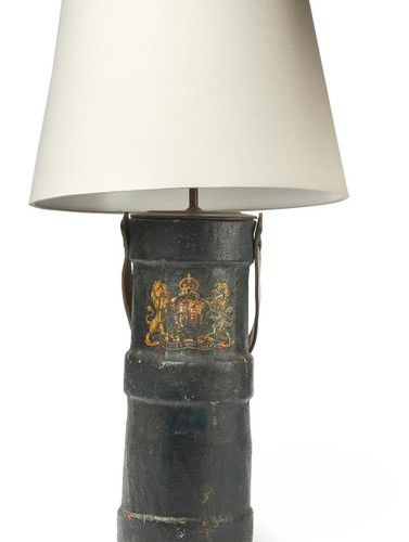A BRITISH MILITARY ARTILLERY SHELL CARRYING CASE CONVERTED TO A TABLE LAMP A BRI…