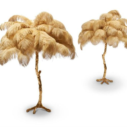 A PAIR OF LARGE GILT RESIN AND OSTRICH FEATHER TABLE LAMPS, BY A MODERN GRAND TO…