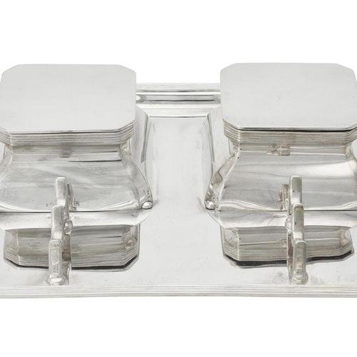 A silver oblong ink stand by Asprey & Co. Ltd. A silver oblong ink stand by Aspr…