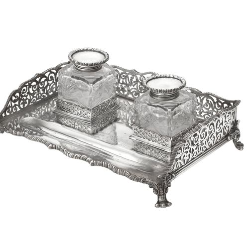 An Edwardian silver rectangular inkstand by Edward Barnard & Sons Ltd. An Edward…