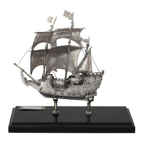 A silver coloured model of a galleon A silver coloured model of a galleon, possi…
