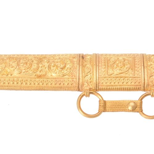 A cased Omani gold coloured mounted scabbard and sword A cased Omani gold colour…