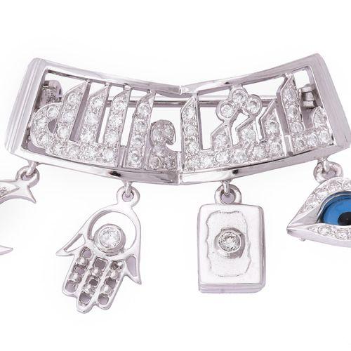 A Bismillah brooch retailed by Mouawad Boutique Une broche Bismillah vendue par …