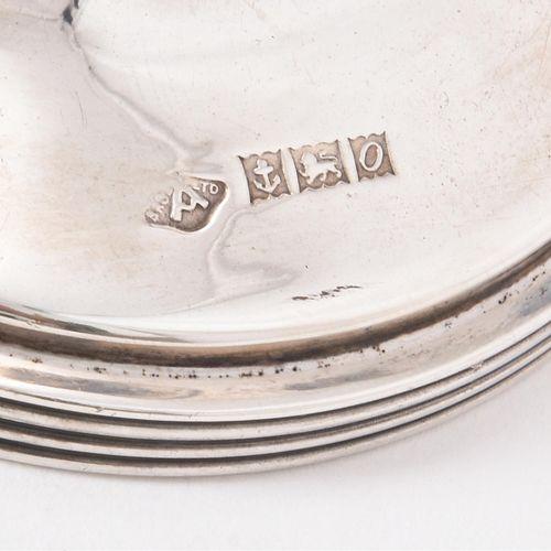 A silver nine branch Menorah by Adie Bros. Ltd. Menorah en argent à neuf branche…