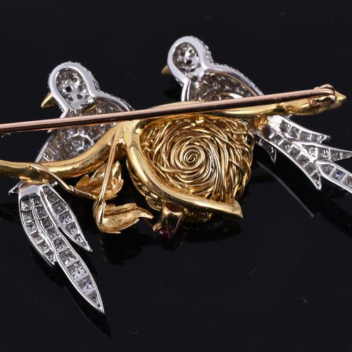 A diamond, ruby and simulated pearl lovebirds brooch Une broche en diamant, rubi…