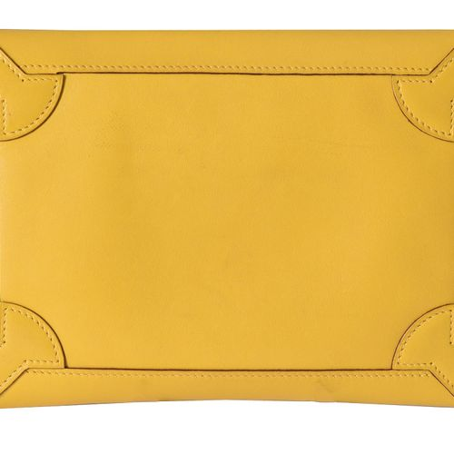 Hermes, a yellow leather clutch bag Hermès, une pochette en cuir jaune, avec un …