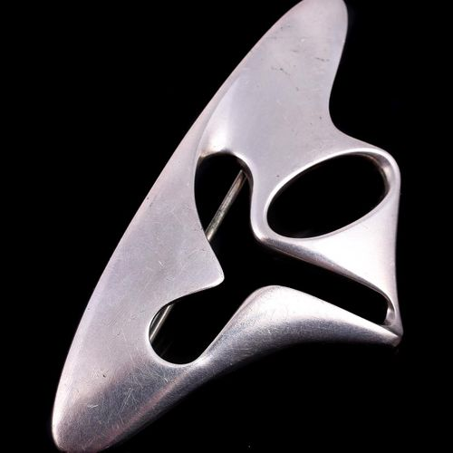 A silver coloured abstract brooch designed by Henning Koppel for Georg Jensen Un…